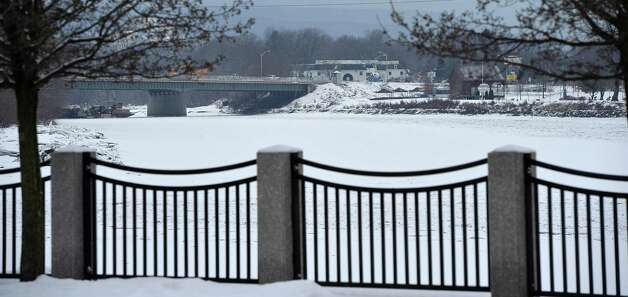 Looking southwest down the Mohawk River Friday afternoon Jan. 10, 2014, from the Stockade area of Schenectady, N.Y., where the ice has remained mostly intact. This may change over the weekend as rain and above freezing temperatures are forecast by the National Weather Service. (Skip Dickstein / Times Union) Photo: Skip Dickstein