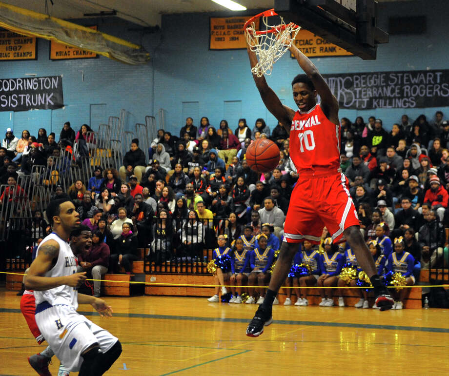 Central's Sha'quan Bretoux follows through on a slam dunk, during boys basketball action against Harding in Bridgeport, Conn. on Friday January 10, 2014. Photo: Christian Abraham / Connecticut Post
