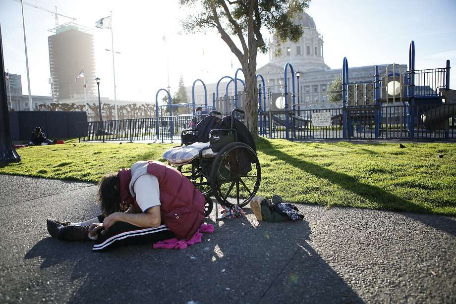 A man in a drug induced stupor sits next to a playground at Civic Center Plaza in San Francisco in January. Photo: Michael Short, The Chronicle