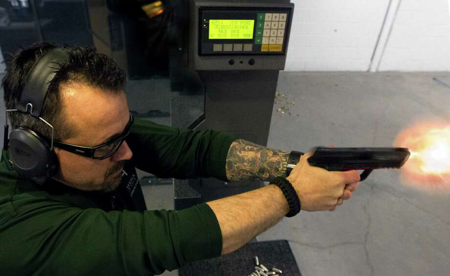 Concealed handgun license instructor Rick Bongiovanni shoots at the Athena Gun Club in Houston. Sen. John Cornyn, R-Texas, introduced a bill allowing armed concealed gun permit holders to travel lawfully to other states. Photo: J. Patric Schneider, Freelance / © 2014 Houston Chronicle