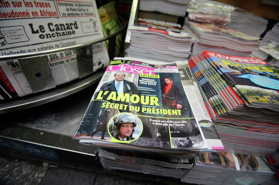 Closer magazine, with photos of President Francois Hollande and actress Julie Gayet on its front page, enjoys prominent display Friday at a Paris newsstand. Photo: Remy De La Mauviniere, STF / AP