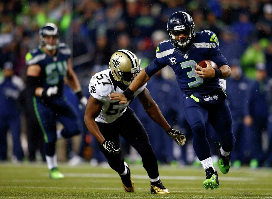 Seattle quarterback Russell Wilson (3) was nearly unstoppable during his first meeting this season with linebacker David Hawthorne (57) and the New Orleans Saints, throwing for 310 yards and three touchdowns in the Seahawks' 34-7 victory Dec. 2. Photo: Jonathan Ferrey, Stringer / 2013 Getty Images