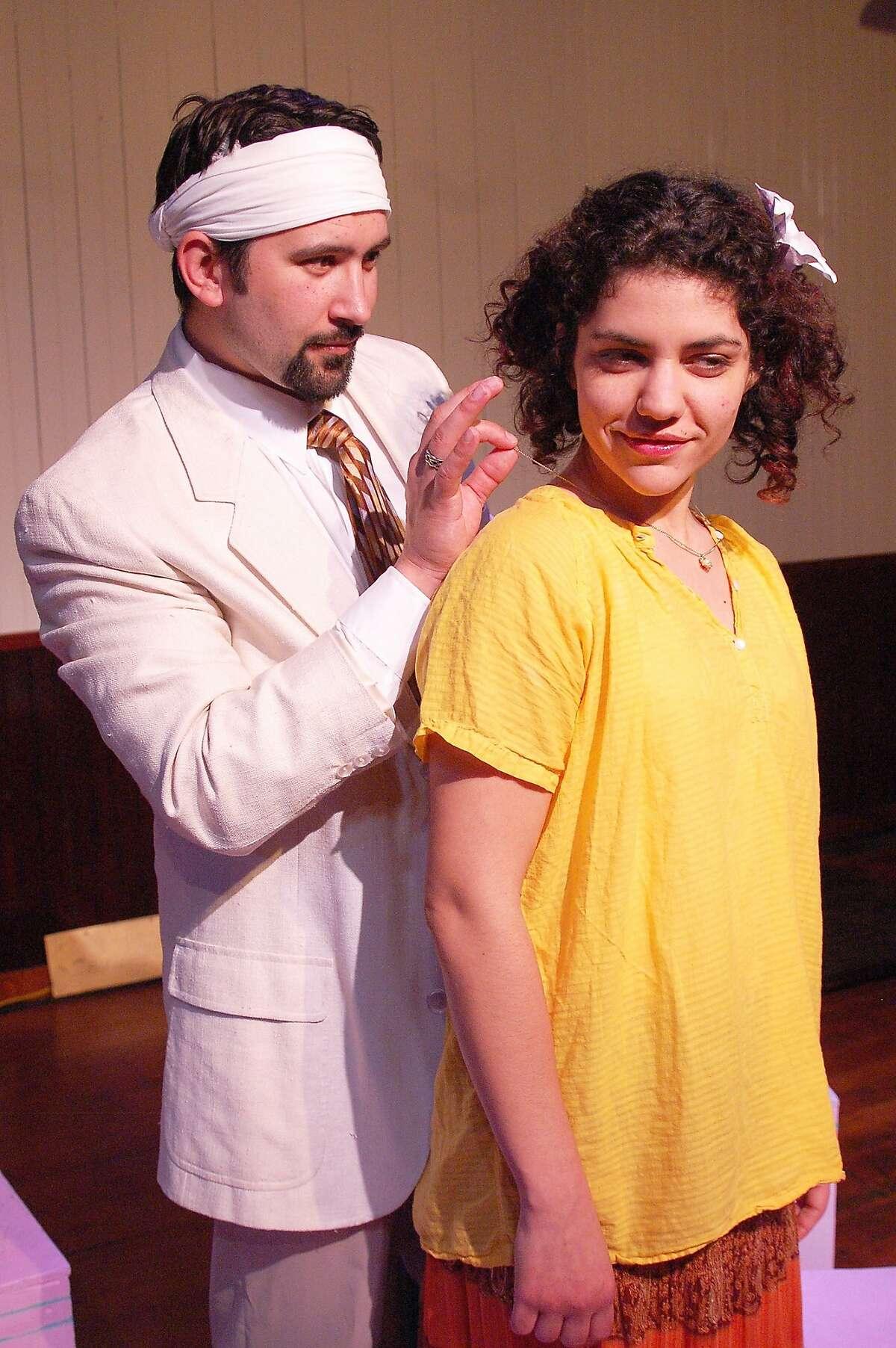 "Moises (Nick Garcia) courts Helena (Carla Pauli) in Alter Theater's ""The River Bride"""
