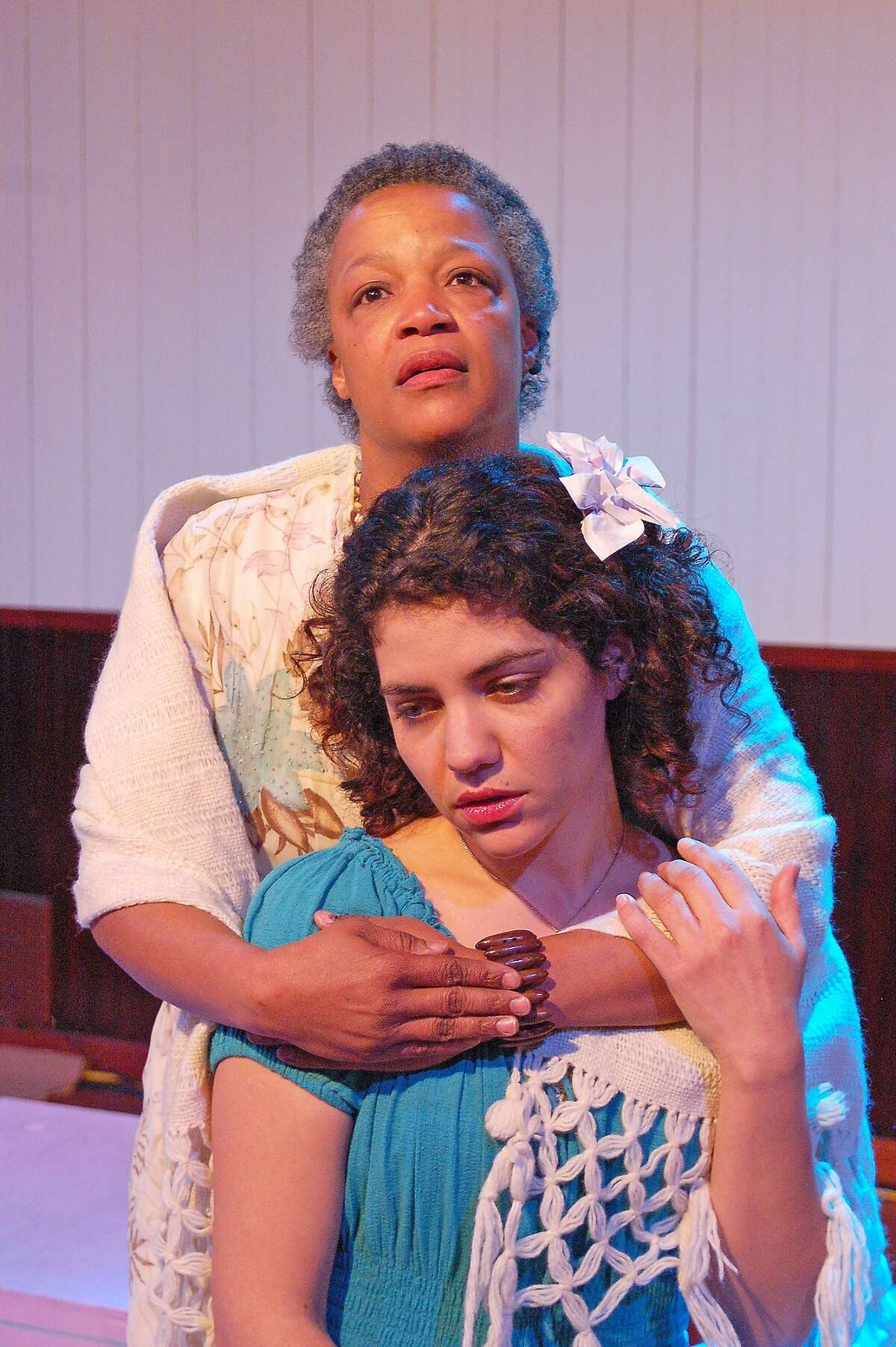 """Senhora Costa (Cathleen Riddley, rear) comforts daughter Helena (Carla Pauli) on the eve of her sister's wedding in Alter Theater's """"The River Bride"""""""