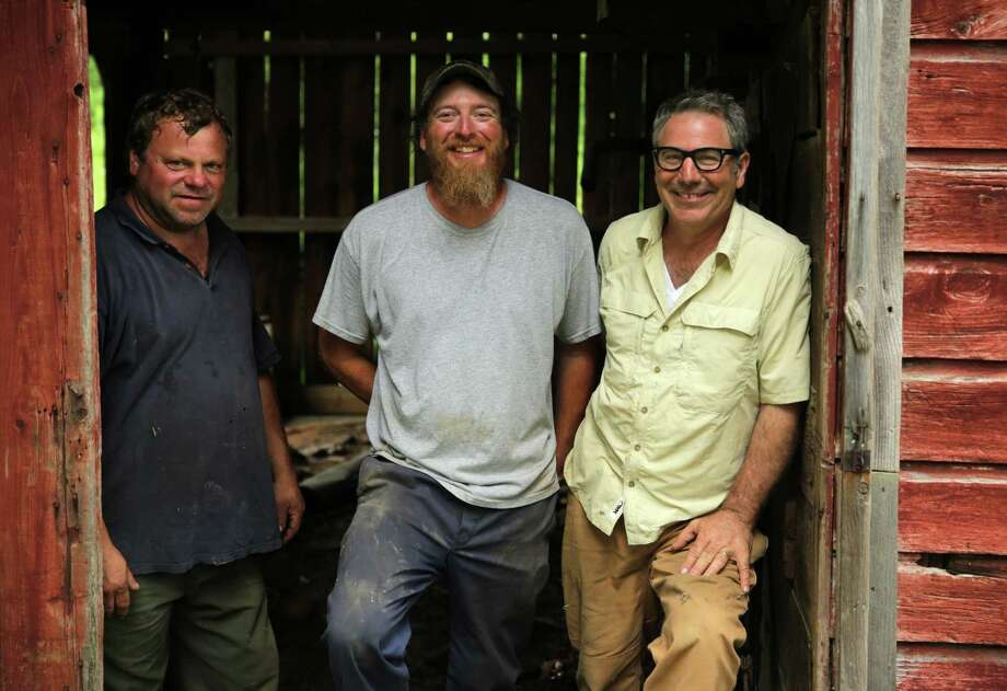 "Pat ""Tuffy"" Bakaitis,left, Mike Carney (landowner) and Paul Dimeo, right, during filming for ""Building Wild,""which airs Tuesday on the National Geographic channel. (Courtesy George Verschoor)"