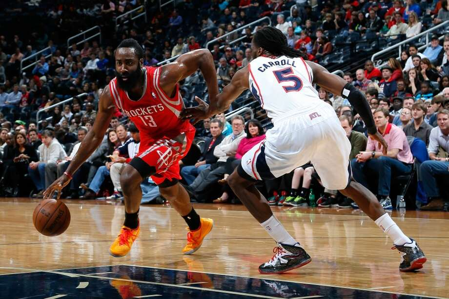 James Harden #13 drives against DeMarre Carroll. Photo: Kevin C. Cox, Getty Images