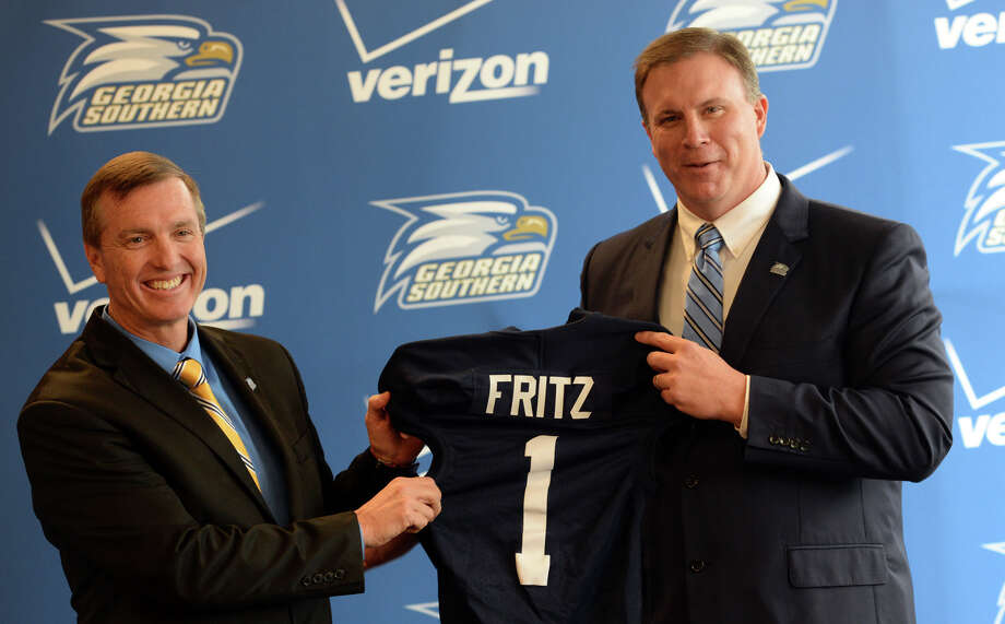 Georgia Southern athletic director Tom Kleinlein, right, presents new head football coach Willie Fritz with a jersey during a news conference at Georgia Southern University in Statesboro, Ga., Friday, Jan. 10, 2014.  (AP Photo/The Morning News, Richard Burkhart)  THE EXAMINER.COM OUT; SFEXAMINER.COM OUT; WASHINGTONEXAMINER.COM OUT Photo: Richard Burkhart, MBR / SAVANNAH MORNING NEWS