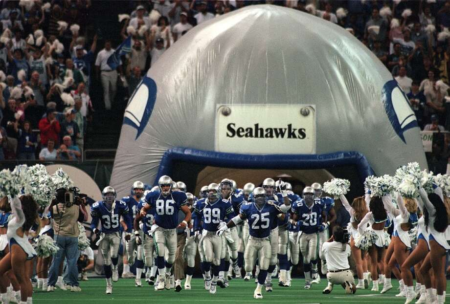 The Seahawks take the field before a New York Jets game in the Kingdome on Aug. 31, 1997. Photo: Grant M. Haller, Seattle P-I Archive