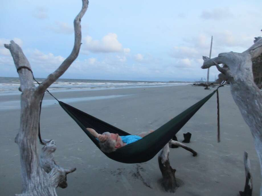 My husband tries out a hammock hanging from some of the bigger branches along the sandy beach. Photo: Terry Scott Bertling, San Antonio Express-News