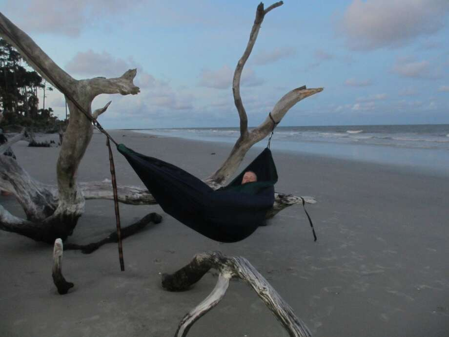 My son finds a good spot for his new hammock with the sounds of the ocean as a backdrop. Photo: Terry Scott Bertling, San Antonio Express-News
