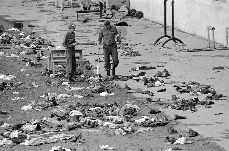"National Guard Corpsmen stand in Attica State PrisonA'A's exercise yard A'A""DA'A"" amid piles of prisonersA'A' clothing after police and guards stormed the stronghold quelling the riot in Attica, New York on Sept. 13, 1971. Nine of the hostages held by the prisoners were killed. (AP Photo) Photo: Anonymous / AP1971"