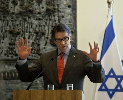 Gov. Rick Perry's recent trips include one in October to Jerusalem, where he announced that the Texas A&M University System would create a campus in Nazareth, Israel. Photo: Associated Press / AP