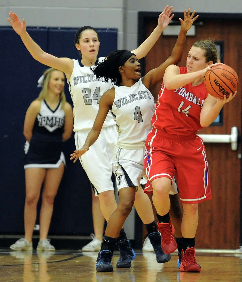 Tomball's Mandy Moerschell, right, looks for a way around the defensive pressure of Tomball Memorial's Emily Chaffin, left, and Tyia Jackson. Photo: Eric Christian Smith, Freelance