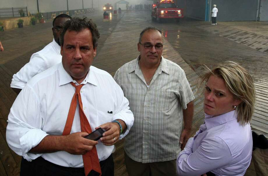 New Jersey Gov. Chris Christie (left front) fired his deputy chief of staff, Bridget Anne Kelly, after emails revealed she was behind the apparent political payback lane closures in September. Photo: Office Of Gov. Chris Christie / Tim Larsen / Associated Press / Office of the Governor