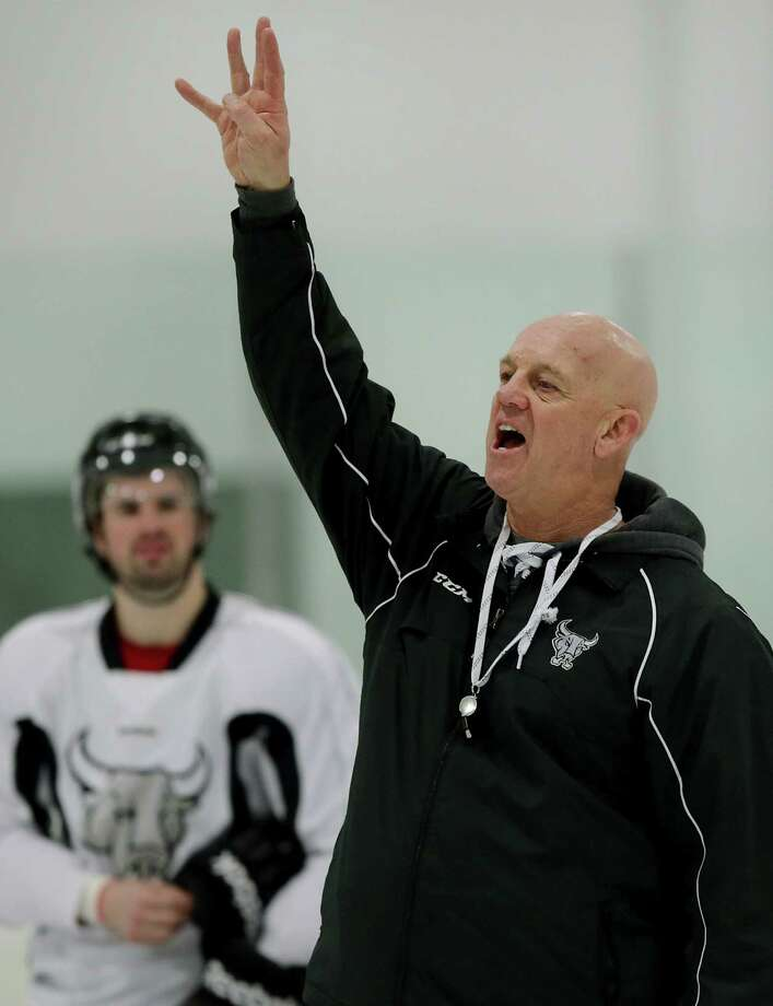 Before taking over the Rampage in November, Tom Rowe (center) coached Lokomotiv Yaroslavl, a traditional Russian power. Rowe not only had to rebuild the team, he had to restore hope to a grieving community after a 2011 plane crash killed 37 players, coaches and support staff. Photo: BOB OWEN, San Antonio Express-News / © 2012 San Antonio Express-News
