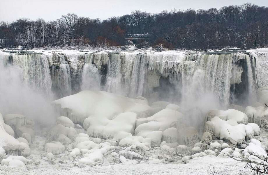 Ice along Niagara Falls and Niagara Falls State Park was photographed from Niagara Falls in Ontario. Photo: JAMES NEISS, Associated Press / The Niagara Gazette