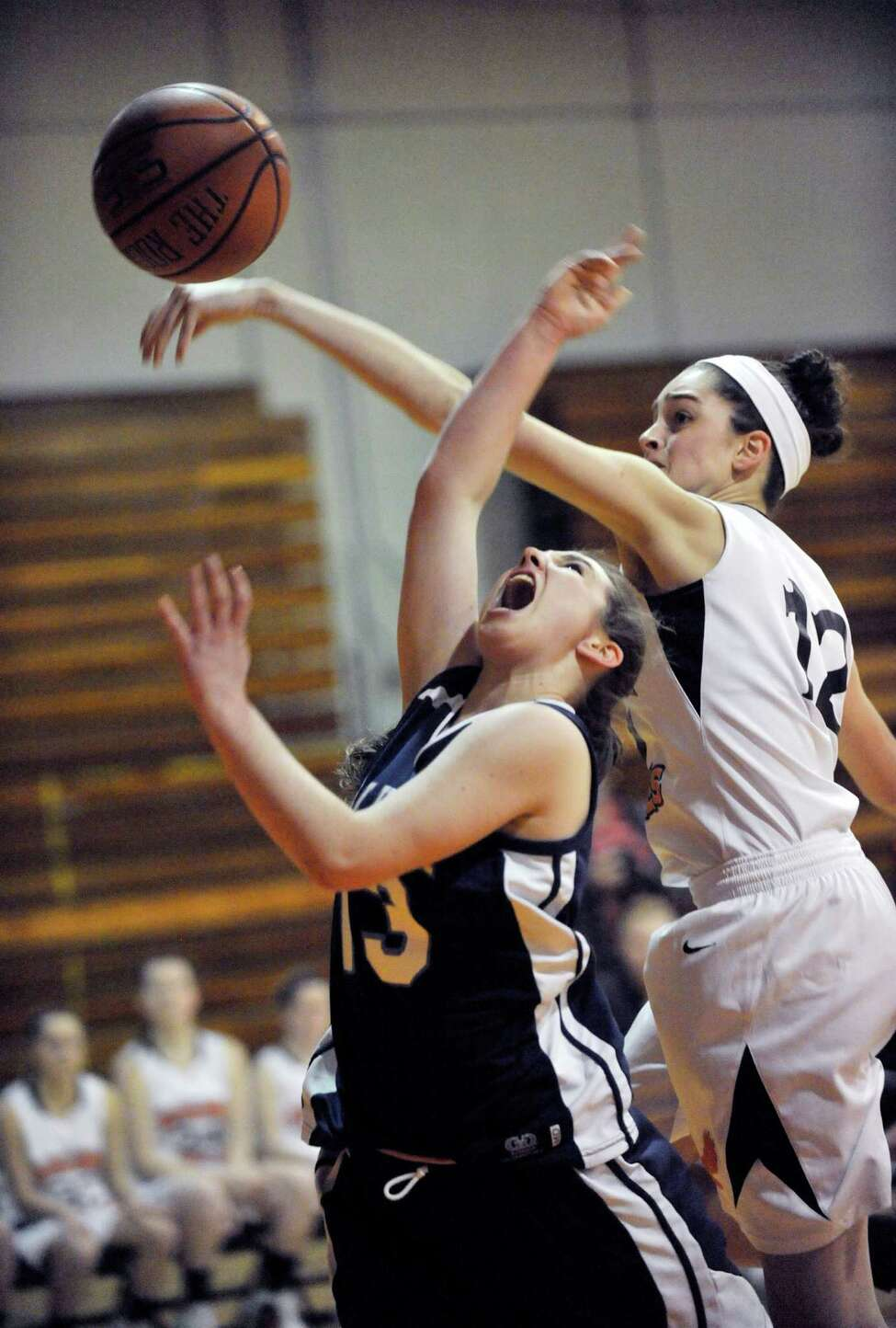 Columbia's Sarah Jaromin ,left, is defended by Bethlehem's Jenna Giacone during their girls' basketballl game in Delmar, N.Y., Friday, Jan. 10, 2014. (Hans Pennink / Special to the Times Union) ORG XMIT: HP101