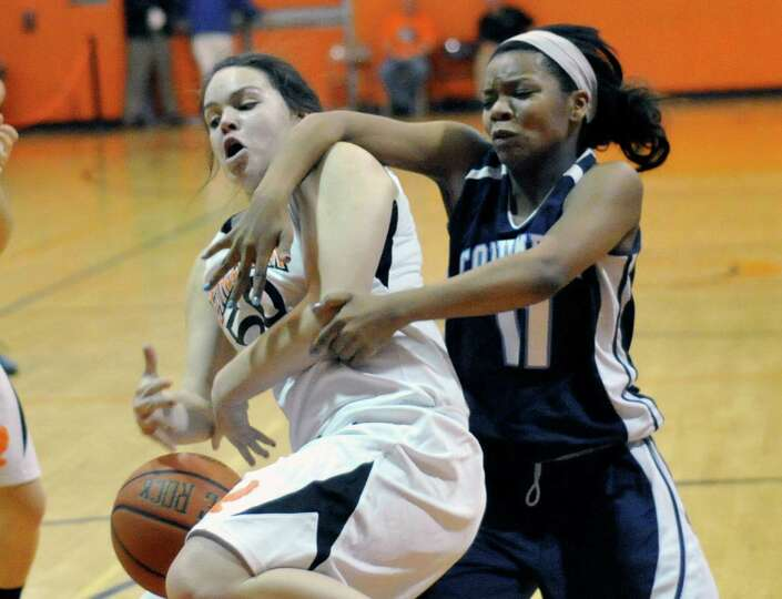 Bethlehem's Erin O'Donnell ,left, and Columbia's Nia Moore fight for a rebound during their girls' b