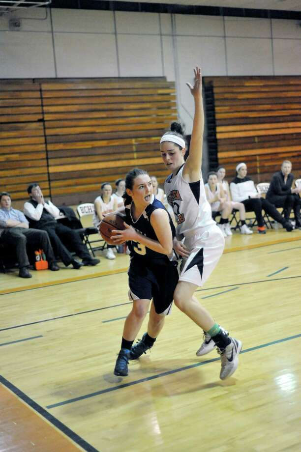 Columbia's Sarah Jaromin ,left, is defended by Bethlehem's Jenna Giacone during their girls' basketballl game in Delmar, N.Y., Friday, Jan. 10, 2014. (Hans Pennink / Special to the Times Union) ORG XMIT: HP108 Photo: Hans Pennink / Hans Pennink