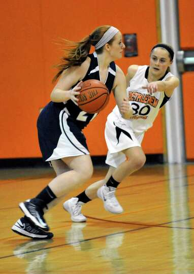 Columbia's Casey Brown ,left, is defended by Bethlehem's Emily Wander during their girls' basketball