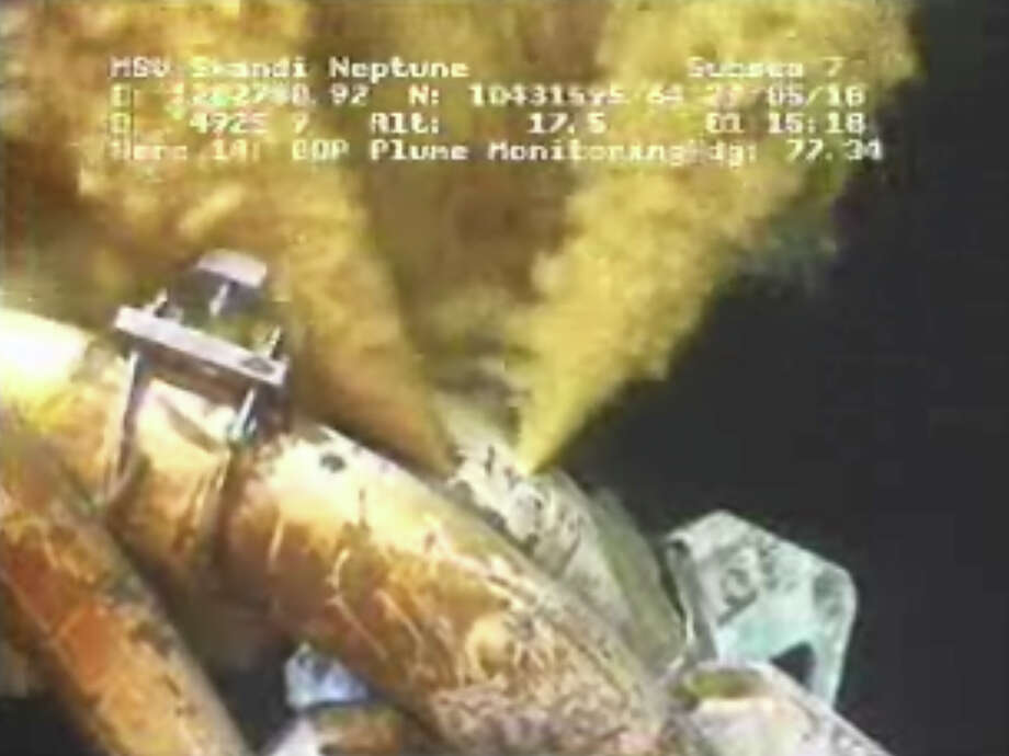 FILE - This image made from video released by British Petroleum (BP PLC) early Saturday morning, May 29, 2010 shows drilling mud escaping from the broken pipe on the gushing oil well in the Gulf of Mexico. Over BP's objections, a federal appeals court on Friday Jan. 10, 2014, upheld a judge's approval of the company's multibillion-dollar settlement with lawyers for businesses and residents who claim the massive 2010 oil spill in the Gulf of Mexico cost them money.  (AP Photo/BP PLC) NO SALES Photo: Anonymous, HO / BP PLC