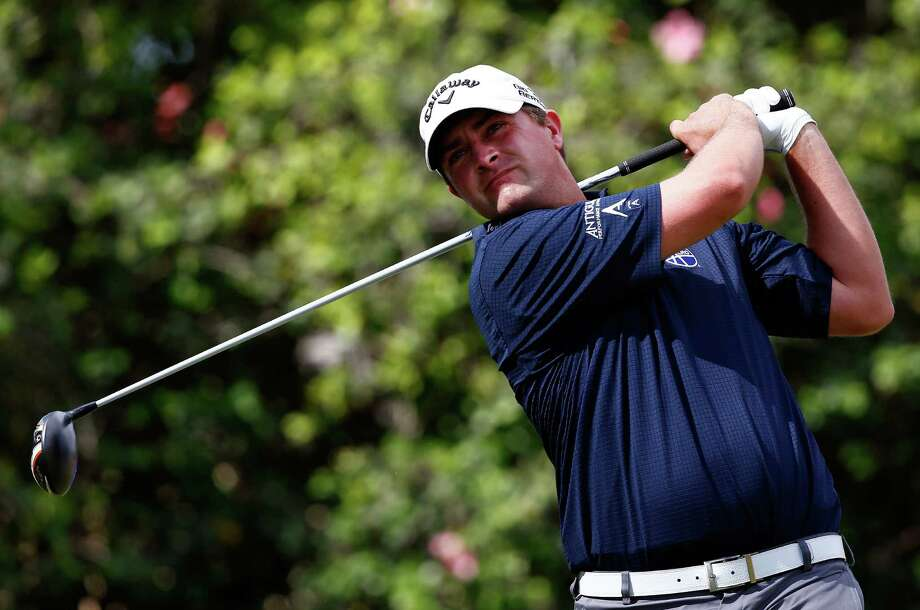 Brian Stuard, who shot another 65 for a one-shot lead after two rounds, hits on the ninth hole at Waialae Country Club. Photo: Tom Pennington / Getty Images / 2014 Getty Images