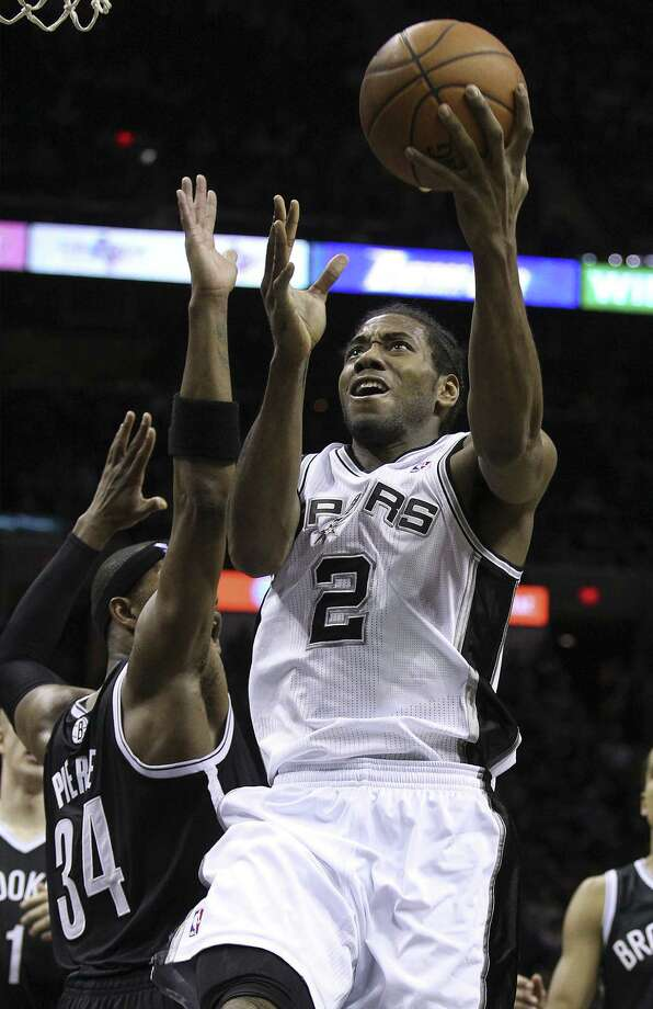 Kawhi Leonard is averaging 11.7 points per game for the Spurs, slightly down from the 11.9 he averaged last season. Photo: Kin Man Hui / San Antonio Express-News / ©2013 San Antonio Express-News