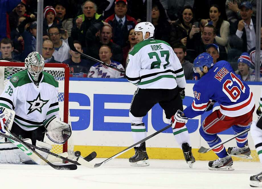NEW YORK, NY - JANUARY 10:  Rick Nash #61 of the New York Rangers scores the game winning goal in the third period as Kari Lehtonen #32 of the Dallas Stars is unable to make the stop at Madison Square Garden on January 10, 2014 in New York City.The New York Rangers defeated the Dallas Stars 3-2.  (Photo by Elsa/Getty Images) ORG XMIT: 181113086 Photo: Elsa / 2014 Getty Images