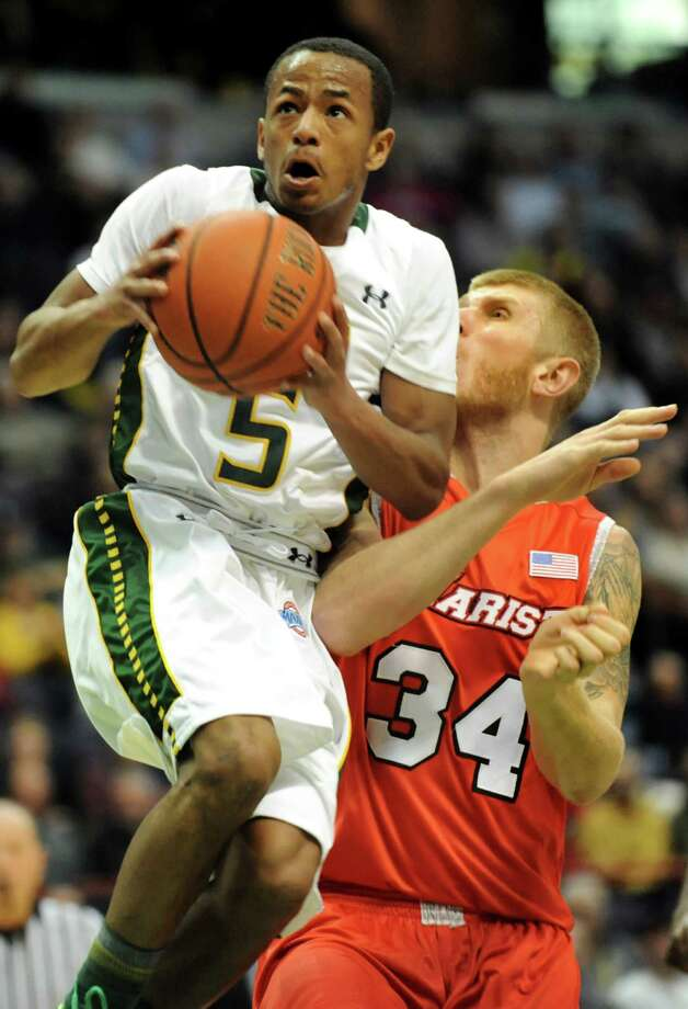Siena's Evan Hymes, left, goes to the hoop as Marist's Pieter Prinsloo defends during their basketball game on Friday, Jan. 10, 2014, at Times Union Center in Albany, N.Y. (Cindy Schultz / Times Union) Photo: Cindy Schultz / 00025111D