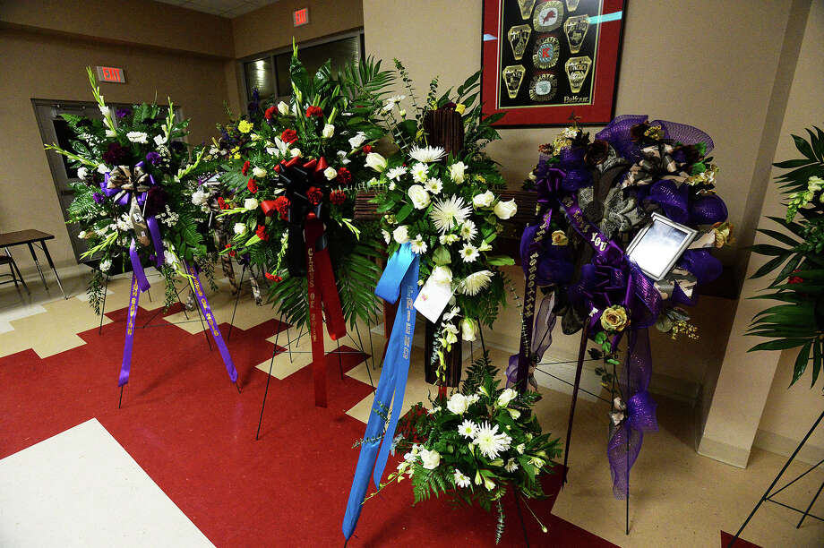 Flower arrangements sit in new gymnasium in preparation for the funeral procession that is being held Saturday for Kountze students who passed away Keiron Edwards and Savion Smith. Michael Rivera/@michaelrivera88   Photo taken Friday, 01/10/2014