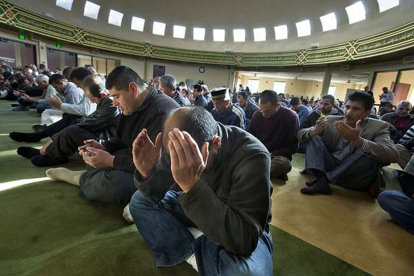 Shah Ahmed, center, and others pray during a special prayer for rain at the Salam Islamic Center in Sacramento, Calif., Friday, Jan. 10, 2014. Local mosques offered a prayer for rain to help relieve the ongoing drought that is impacting area residents and agriculture. (AP Photo/The Sacramento Bee, Randall Benton)  MAGS OUT; LOCAL TV OUT (KCRA3, KXTV10, KOVR13, KUVS19, KMAZ31, KTXL40); MANDATORY CREDIT
