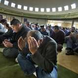 Shah Ahmed, center, and others pray during a special prayer for rain at the Salam Islamic Center in Sacramento, Calif., Friday, Jan. 10, 2014. Local mosques offered a prayer for rain to help relieve the ongoing drought that is impacting area residents and agriculture.