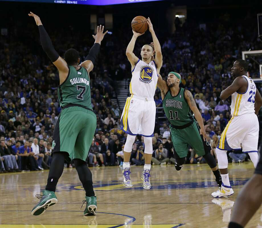 Stephen Curry launches a three-point attempt from between Jared Sullinger and Jerryd Bayless in the second half. Curry later hit the game-winning shot just inside the arc with 2.1 seconds remaining. Photo: Marcio Jose Sanchez, Associated Press