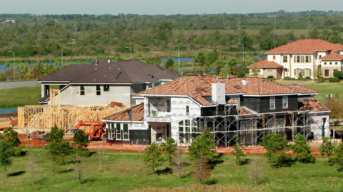 A house sits under construction at the Cross Creek Ranch subdivision Friday, Nov. 1, 2013 in Fulshear. Fulshear, a town way out from Houston's center, has become one of the region's fastest growing areas with a booming population from 400 in 2000 to 5,000 plus today. City and county leaders are working double time to keep up with the growth and that includes efforts to connect to major thoroughfares and widen its farm to market roads that wind through town. (Cody Duty / Houston Chronicle)