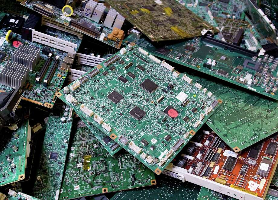 Circuit boards provide just a trickle in the revenue stream for California recyclers. Some 50 million tons of electronic scrap is discarded each year worldwide. Photo: MINDY SCHAUER,, MBR / Orange County Register