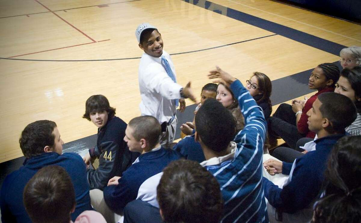 King student Eric Joyner is congratulated by his classmates after signing a letter of intent to play football at New Hampshire in Stamford, Conn. on Wednesday, Feb. 3, 2010.