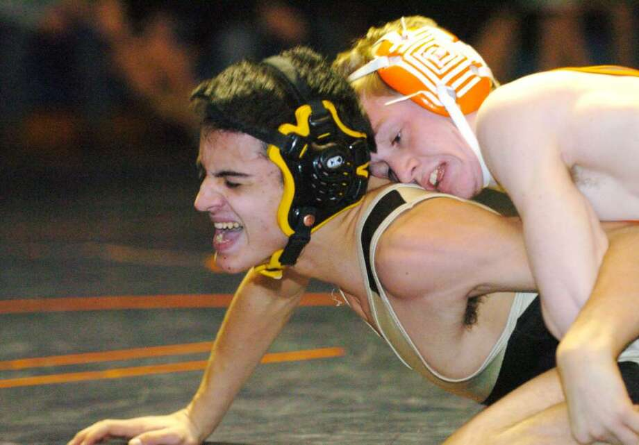 Danbury's Brian Jennings wrestles Trumbull's Joey Alloi during the wresteling match at Danbury High Wednesday, Feb. 3, 2010. Photo: Chris Ware / The News-Times