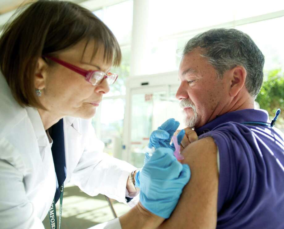To mamke sure he was prepared for the flu season early, Paul Ginotti hot his flu shot from Sandra Morano at Government Center in Stamford last fall. Photo: Lindsay Perry / Stamford Advocate