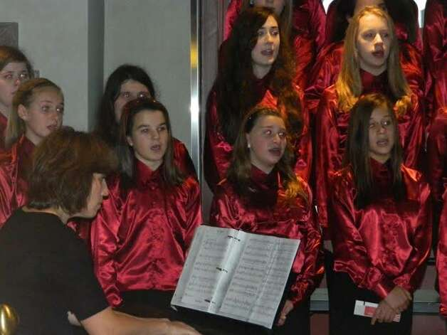 The Farnsworth Middle School select choir in Guilderland, directed by Terri Mewhorter, performed at the Empire State Building?s observation deck in New York City. The students, in grades 6 to 8, were the first group invited to perform in more than 80 years, according to the school. (Submitted photo)