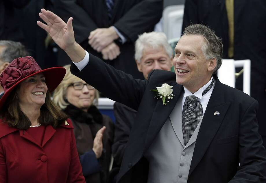 Terry McAuliffe celebrates his inauguration with his wife, Dorothy, and Bill and Hillary Clinton. Photo: Patrick Semansky, Associated Press