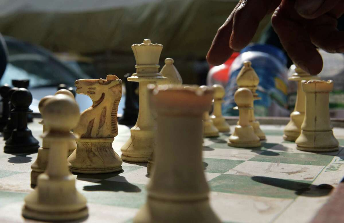 An Indian commuter plays a chess move during a game on the roadside in Kolkata on November 20, 2013. We can't keep everything locked down because the economy can't handle it. We can't rely on herd immunity (Bhopal prefers to use the term