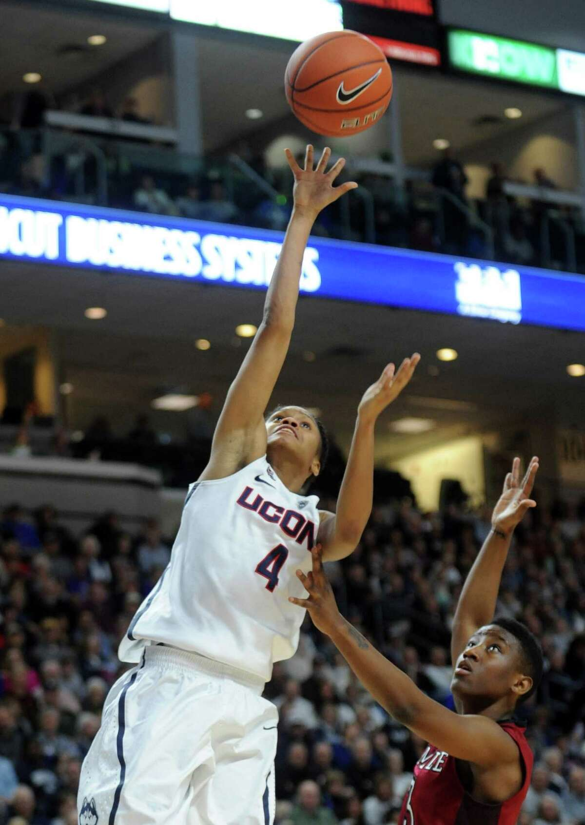 University of Connecticut's Moriah Jefferson goes in for the layup as Temple's Rateska Brown defends during their game Saturday, Jan. 11, 2014 at the Webster Bank Arena in Bridgeport, Conn.