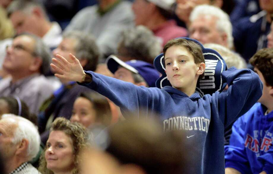 Eleven-year-old Corbett Owen, of Shelton, dances in the stands as the UConn women's basketball team takes on Temple University Saturday, Jan. 11, 2014 at the Webster Bank Arena in Bridgeport, Conn. Photo: Autumn Driscoll / Connecticut Post