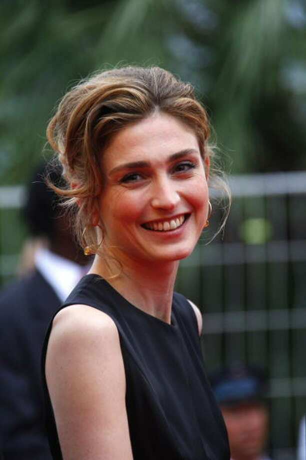 French actress Julie Gayet arrives for the screening of the movie Chun Feng Chen Zui De Ye Wan (Spring Fever) in competition at the 62nd Cannes Film Festival on May 14, 2009. Defying the authorities, controversial Chinese director Lou Ye is offering a movie on love and homosexuality at the Cannes film festival this week that was shot on the quiet in east China despite a state work ban.      AFP PHOTO / VALERY HACHE (Photo credit should read VALERY HACHE/AFP/Getty Images) Photo: VALERY HACHE, AFP/Getty Images / 2009 AFP