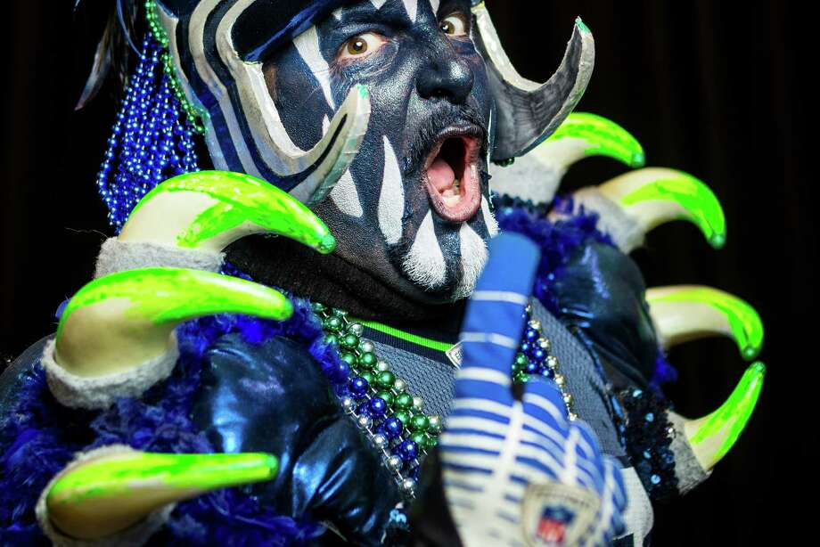 Known for enthusiasm, and for raining more than 130 decibels of fierce roar down on opponents, seattlepi.com asked Seahawks 12th Man to show us their best game face. Photo: JOSHUA TRUJILLO, SEATTLEPI.COM / SEATTLEPI.COM