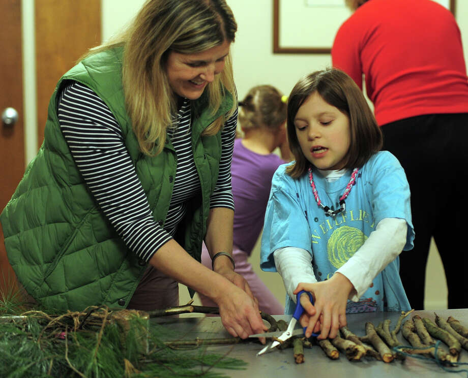 """The Connecticut Audubon Society held a """"how-to"""" class for children on fashioning a pair of snowshoes out of white pine branches, at the center in Fairfield, Conn. on Saturday January 11, 2014. Photo: Christian Abraham / Connecticut Post"""