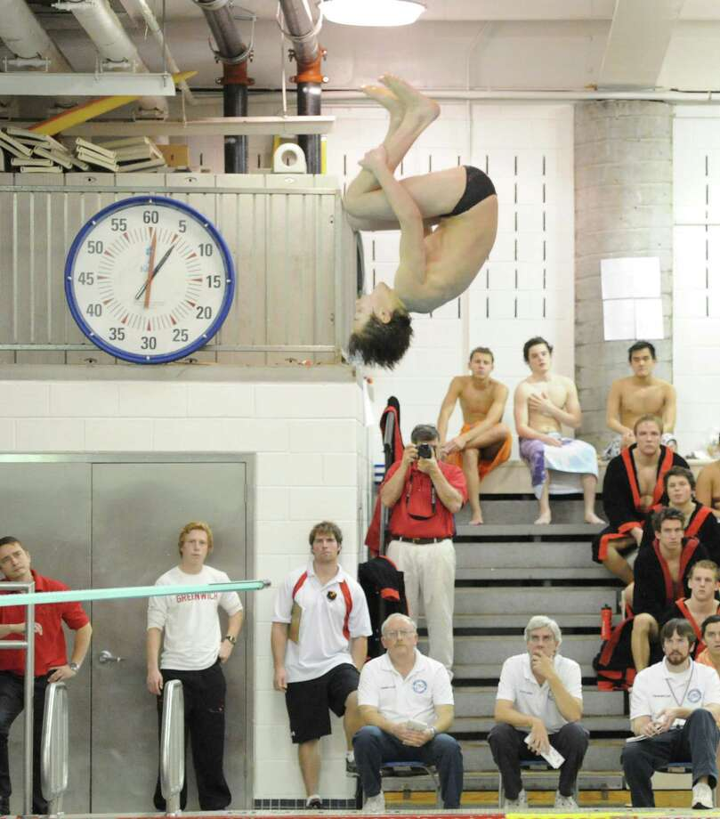 Greenwich High School diver Justin Sodokoff in action during the boys high school swim meet between Greenwich High School and Fairfield Prep at Greenwich, Saturday, Jan. 11, 2014. Photo: Bob Luckey / Greenwich Time