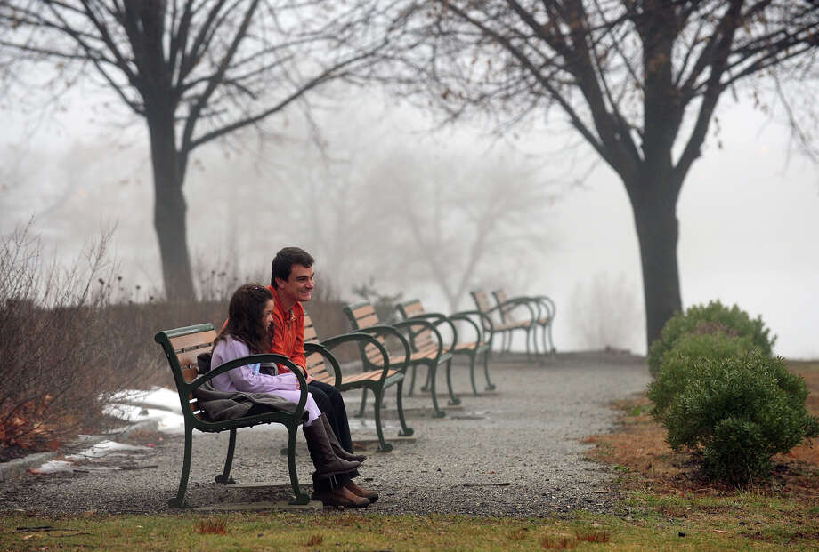 Marcelo Cabral spends some time with his daughter Bella, 6, as a fog hangs over Beardsley Park in Bridgeport, Conn. on Saturday January 11, 2014. Photo: Christian Abraham / Connecticut Post