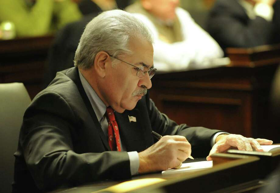 Albany County Legislator Frank Commisso takes notes during a meeting of the of the Albany County Legislature at the Albany County Courthouse on Monday, Jan. 6, 2014 in Albany, N.Y. (Lori Van Buren / Times Union) Photo: Lori Van Buren / 00025158A