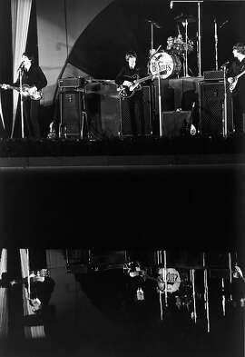 23rd August 1964: British pop group The Beatles, and their reflection, playing live at the Hollywood Bowl.